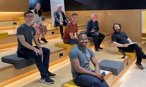 Graphene Hackathon 2021: organisers and speakers at the Bright Building in Manchester Science Park