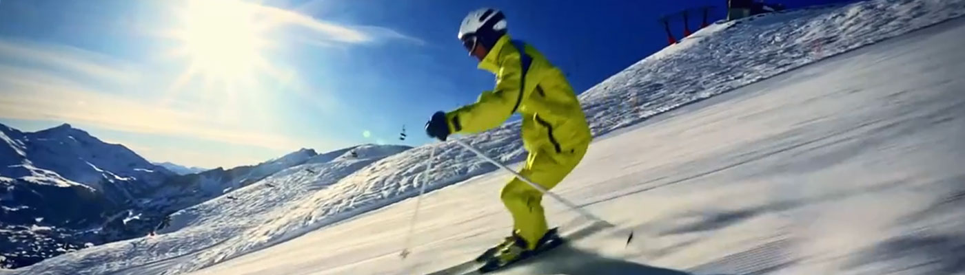 man skiing down a hill